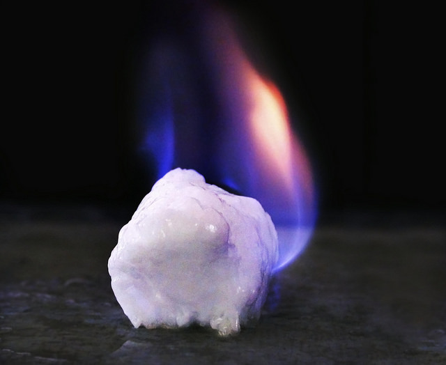 Gas hydrate is an ice like solid that results from the trapping of methane molecules, the main component of natural gas, within a lattice like cage of water molecules. Also known as fire ice or ice that burns, it releases methane gas when it melts.